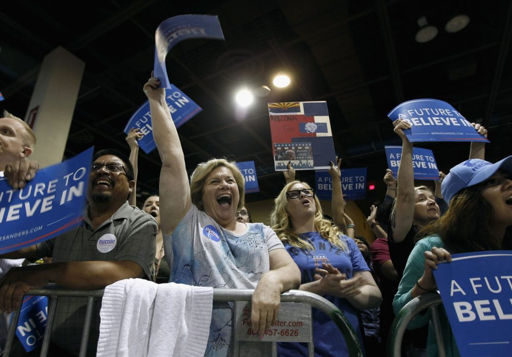 Members of the crowd show their support for Democratic presidential candidate Sen. Bernie Sanders (D-VT) at the Phoenix Convention Center during a campaign rally on March 15, 2016 in Phoenix, Arizona. (Ralph Freso/Getty Images)
