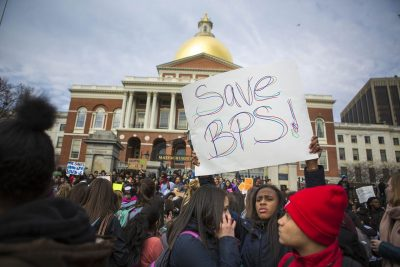 Boston Public School students rallying in front of the Statehouse. (Jesse Costa/WBUR)