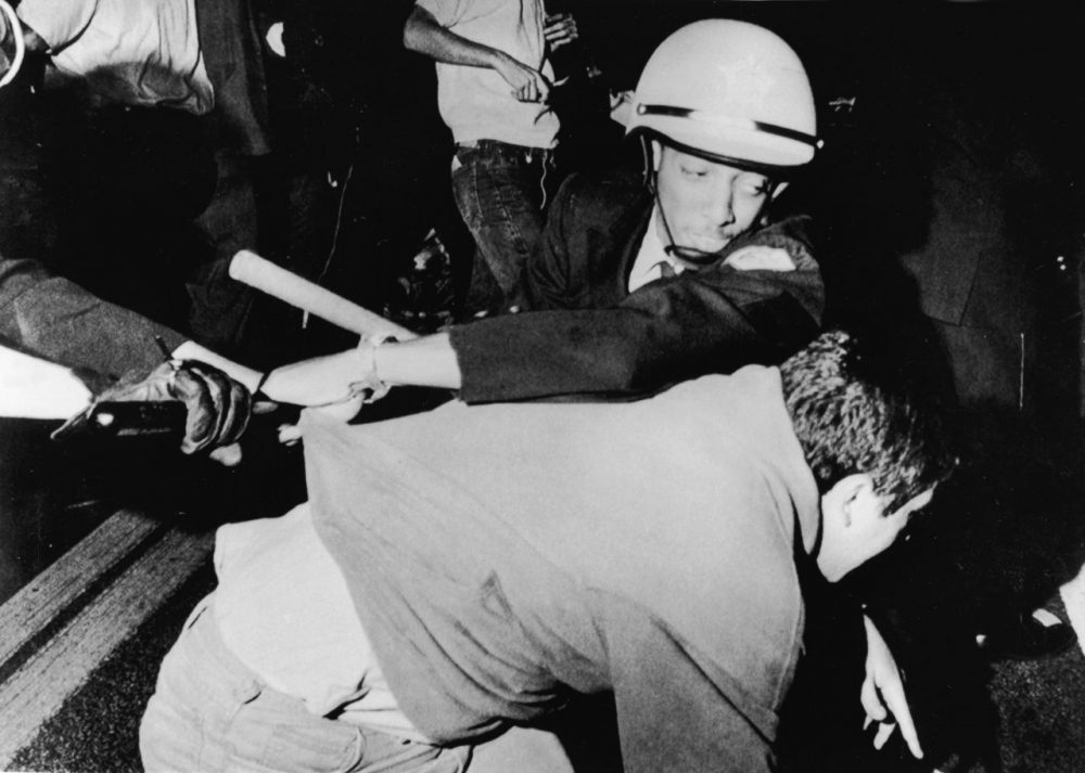 An officer from the Chicago Police Department struggles with an antiwar demonstrator outside Democratic headquarters at the Hilton Hotel on Michigan Avenue as demonstrators attempt to break through police lines to move the protest to the 1968 Democratic National Convention, being held five miles away at the International Amphitheatre, Chicago, Illinois, August 28, 1968. (APA/Getty Images)