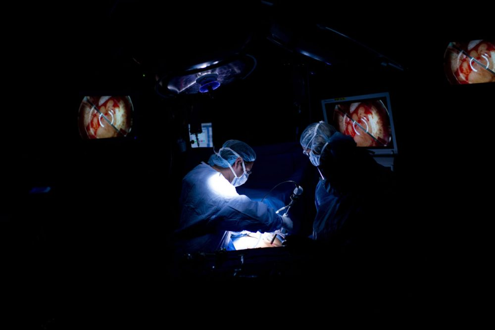 Dr. Dorry Segev performs arthroscopic surgery during a kidney transplant at Johns Hopkins Hospital June 26, 2012 in Baltimore, Maryland. The US Supreme Court is expected to announce their decision on the US President Barack Obama's healthcare law on June 28. (BRENDAN SMIALOWSKI/AFP/Getty Images)