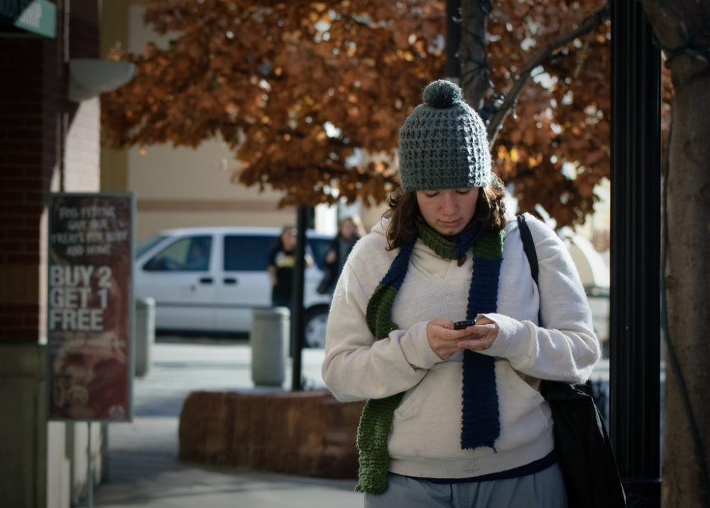 A New Jersey lawmaker has proposed fining people who text while crossing the street. (Don LaVange/Flickr)