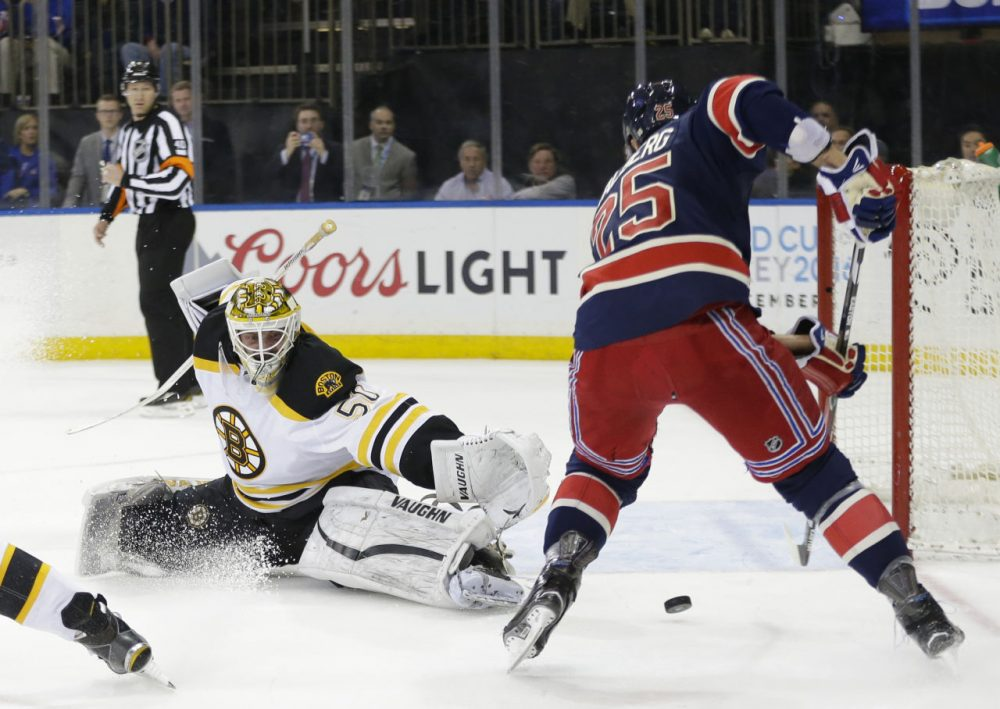 Boston Bruins goalie Jonas Gustavsson (50) deflects a shot by New York Rangers' Viktor Stalberg (25) during yesterday's game. (Frank Franklin II/AP)