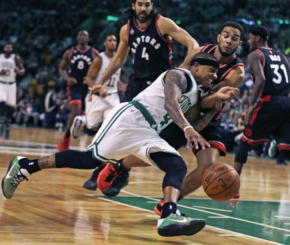 Boston Celtics guard Isaiah Thomas (4) drives to the basket against Toronto Raptors guard Cory Joseph (6) during the first quarter of an NBA basketball game in Boston, Wednesday, March 23, 2016. (Charles Krupa/AP)