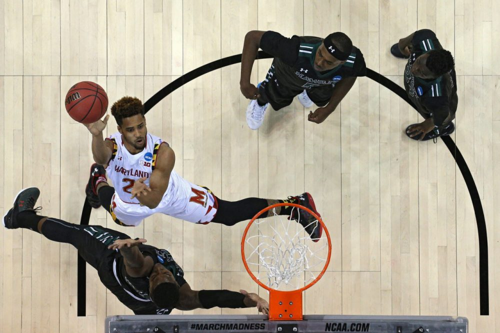 Melo Trimble #2 of the Maryland Terrapins shoots in front of Hawaii Warriors defenders during the second round of the NCAA Men's Basketball Tournament at Spokane Veterans Memorial Arena on March 20, 2016 in Spokane, Washington. (Patrick Smith/Getty Images)