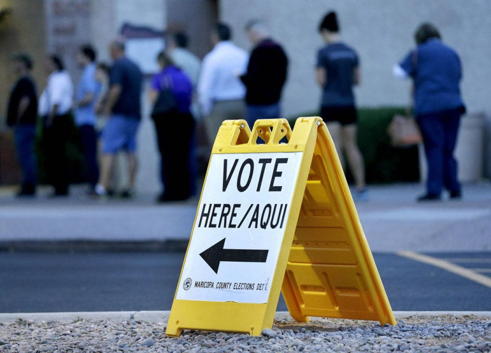 Voters wait in line at dawn to cast their ballot in Arizona's presidential primary on Tuesday, March 22, 2016, in Phoenix. (Matt York/AP)