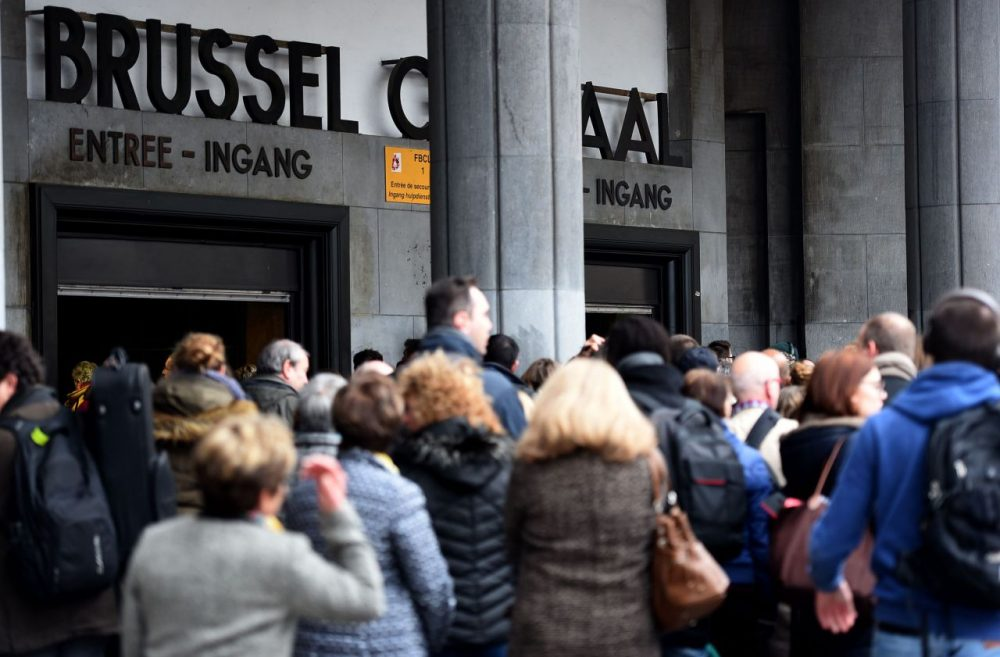 People walk into grand central station on March 24 in Brussels, two days after terrorist attacks in Zaventem airport and Brussels subway Maelbeek that killed 31 and injured 300 people, (Patrik Stollarz/Getty Image)