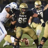 Joey Gaston (#65) weighed 280 pounds at the end of his senior season. A little over two months later, he was down to 240. (Courtesy of Navy)