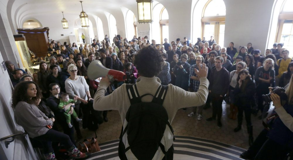 Students, faculty and supporters listen to a speaker during a rally protesting a series of tuition increases at the  University of California, Berkeley, Tuesday, Dec. 2, 2014. (Jeff Chiu/AP)