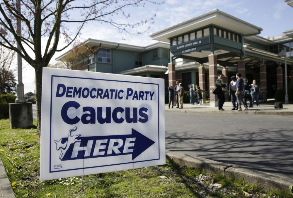 People take part in Washington state Democratic caucuses at Martin Luther King Elementary School in Seattle on March 26, 2016. (Jason Redmond/AFP/Getty Images)