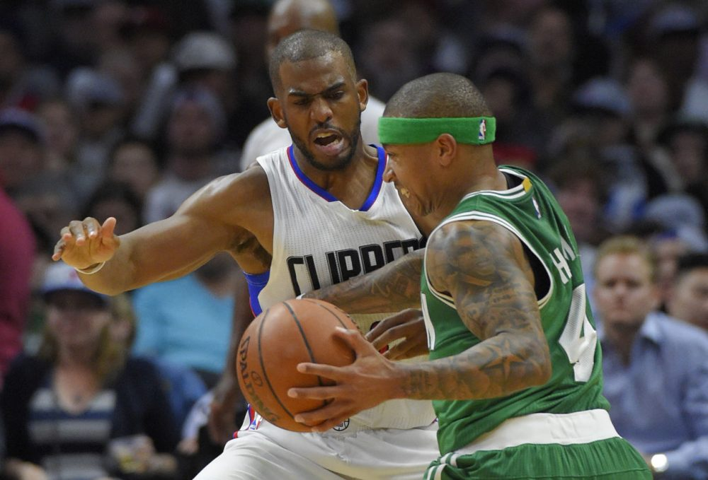 Boston Celtics guard Isaiah Thomas, right, drives against Los Angeles Clippers guard Chris Paul during yesterday's game in Los Angeles. The Clippers won 114-90. (Mark J. Terrill/AP)