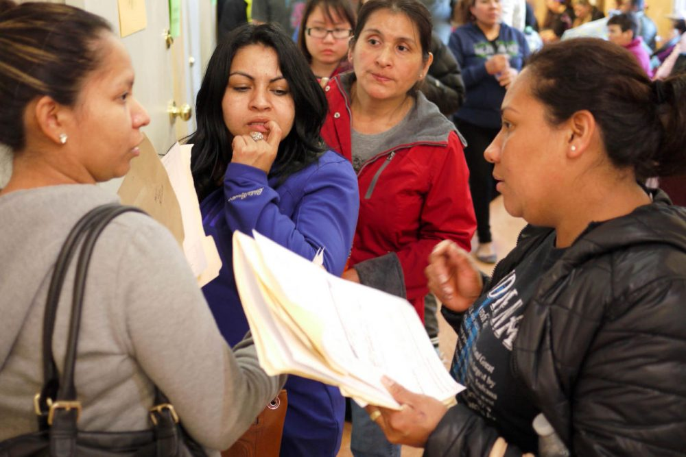 Waiting in line at Centro de la Raza in Seattle for a shot at 110 units of affordable housing. (Liz Jones/KUOW)