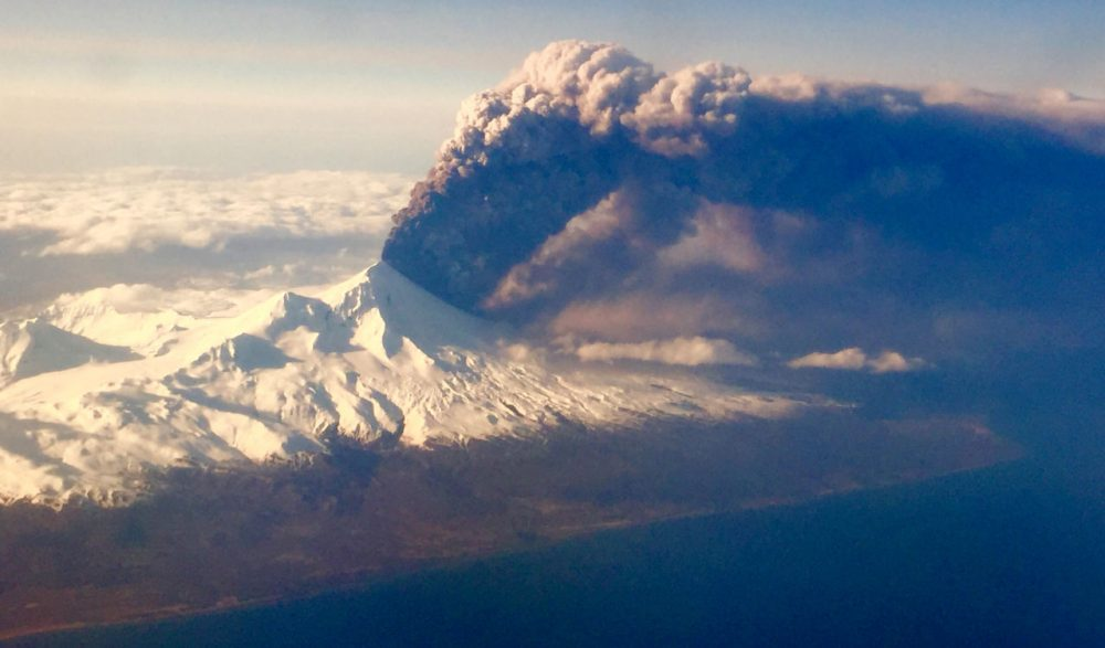 In this Sunday, March 27, 2016, photo, Pavlof Volcano, one of Alaska's most active volcanoes, erupts, sending a plume of volcanic ash into the air. The Alaska Volcano Observatory says activity continued Monday. Pavlof Volcano is 625 miles southwest of Anchorage on the Alaska Peninsula, the finger of land that sticks out from mainland Alaska toward the Aleutian Islands. (Colt Snapp/AP)