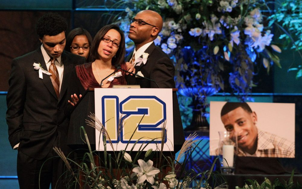 """Family members of Danroy """"D. J."""" Henry talk about him during a memorial service at the Boston Convention and Visitor Center on Oct. 29, 2010. (Stephan Savoia/AP)"""