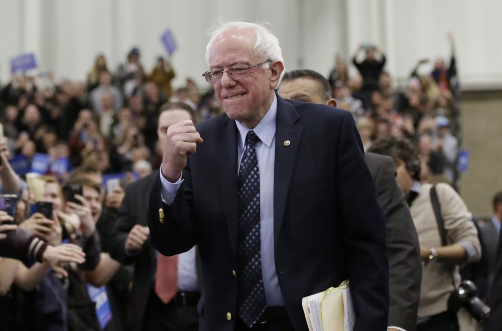 Democratic presidential candidate Sen. Bernie Sanders pumps his fist as he arrives for a rally in Warren, Michigan. (Carlos Osorio/AP)