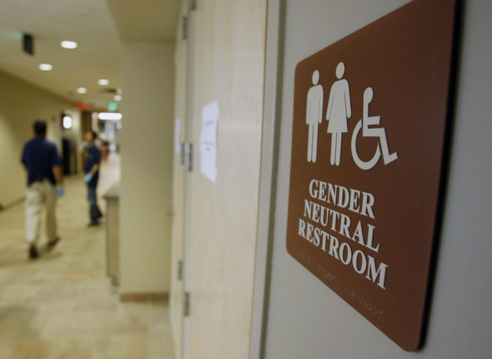 Gov. Charlie Baker won't say whether he supports the bill, which would expand anti-discrimination protections for transgender people from the areas of housing and employment to include public accommodations -- such as gender-segregated restrooms. Here, a sign marks the entrance to a gender-neutral restroom at the University of Vermont in Burlington, Vermont. (Toby Talbot/AP/File)