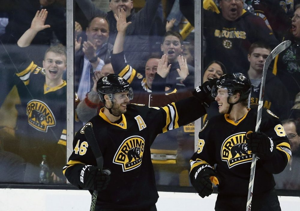 Bruins' David Pastrnak (88) celebrates his goal with David Krejci (46) during the third period a game against the New York Islanders in Boston on Saturday. (Michael Dwyer/AP)
