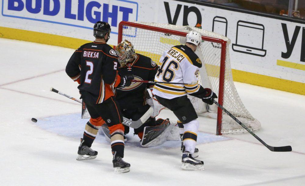 Anaheim Ducks goalie Frederik Andersen turns away a shot by Bruins center David Krejci during a game Friday, in Anaheim, California. (Lenny Ignelzi/AP)