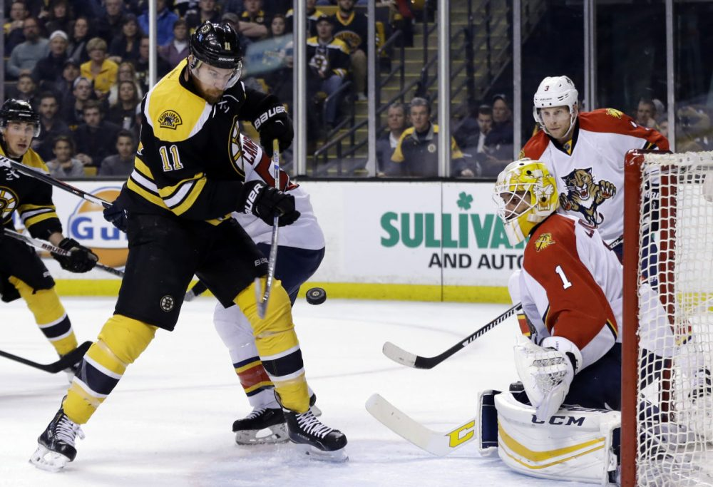 Bruins right wing Jimmy Hayes (11) tries to bat the puck in, but doesn't score against Florida Panthers goalie Roberto Luongo (1) in Thursday night's game in Boston. (Elise Amendola/AP)