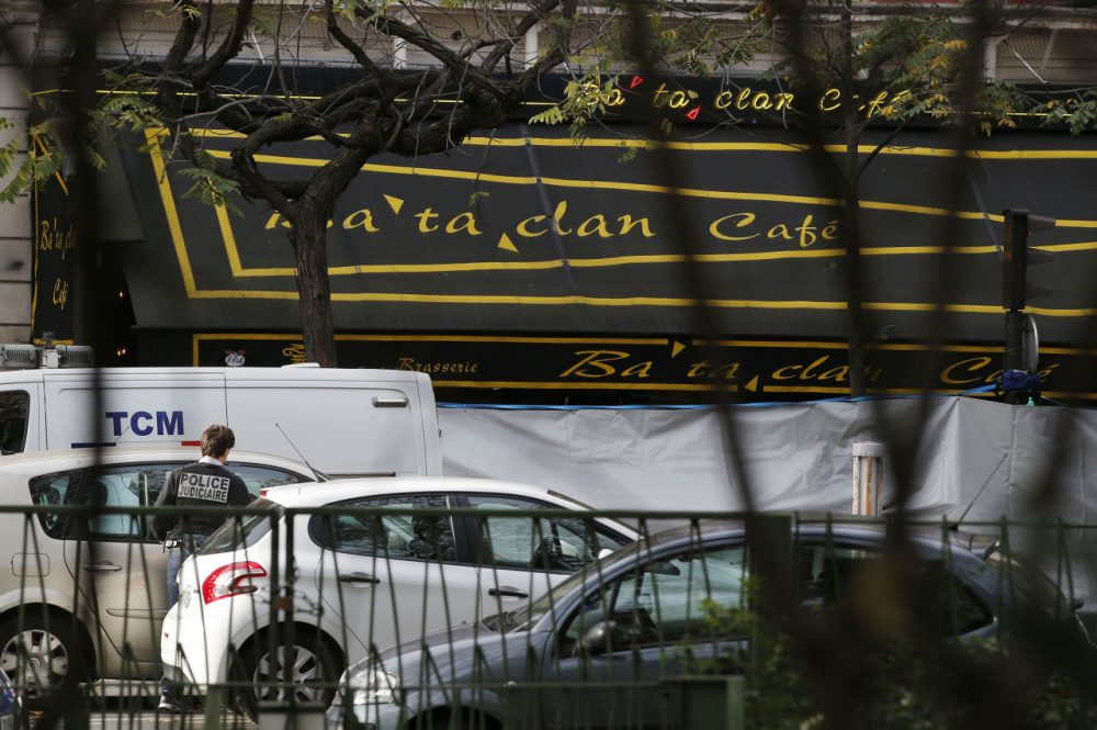 A police officer works outside the Bataclan concert hall the day after more than 100 people were killed in terrorists attacks across Paris, including inside the Bataclan. (Michel Euler/AP)