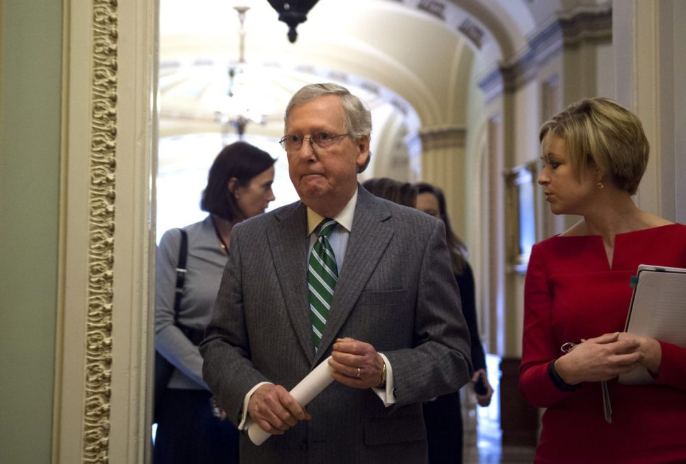 Senate Majority Leader Mitch McConnell walks from the chamber after a cloture vote on Capitol Hill in Washington on Wednesday. (Molly Riley/AP)