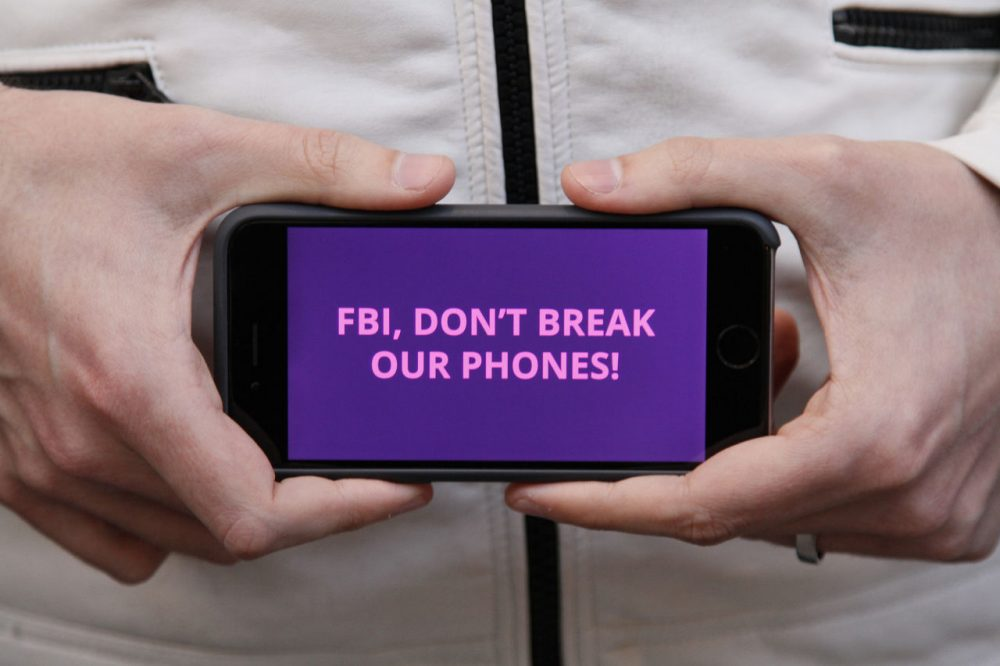Protesters in more than 30 cities have lashed out at the FBI for obtaining a court order that requires Apple to make it easier to unlock an encrypted iPhone. (Eric Risberg/AP)