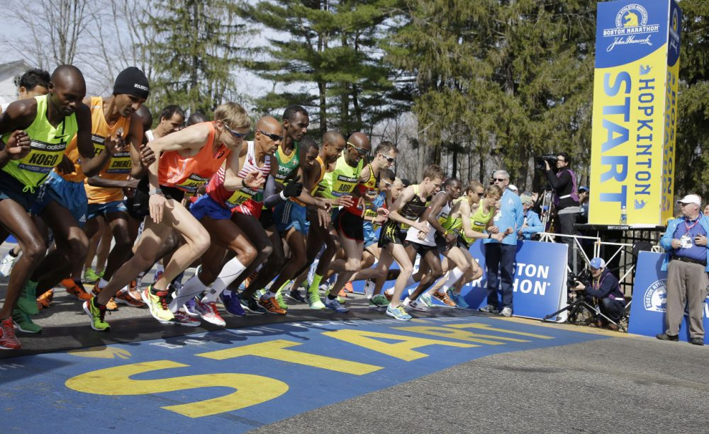 Elite male runners leave the starting line of the 2014 Boston Marathon. (Stephan Savoia/AP)