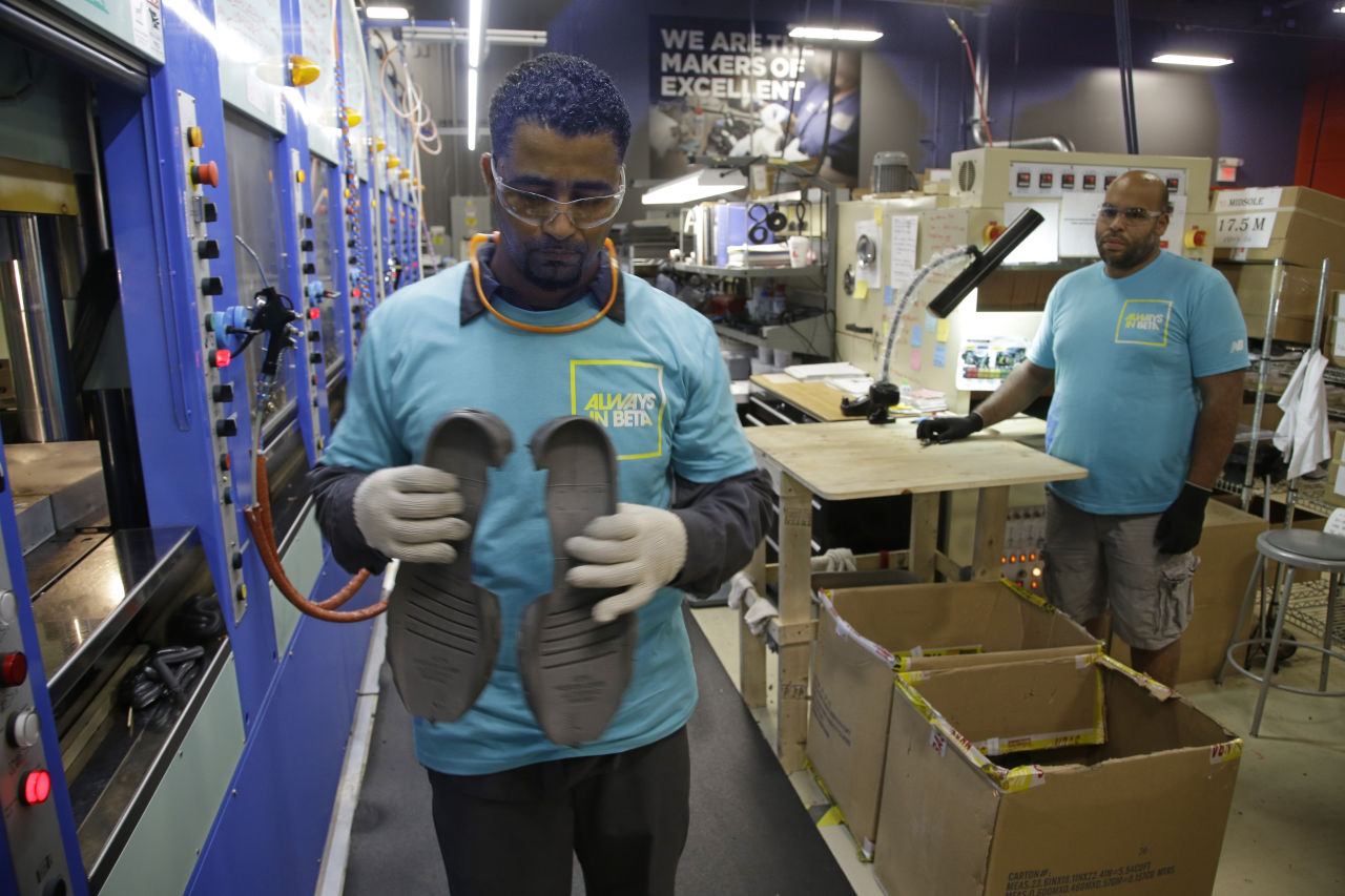 In this July 1, 2015, file photo, employees work at a New Balance manufacturing facility in Boston. (Stephan Savoia/AP)