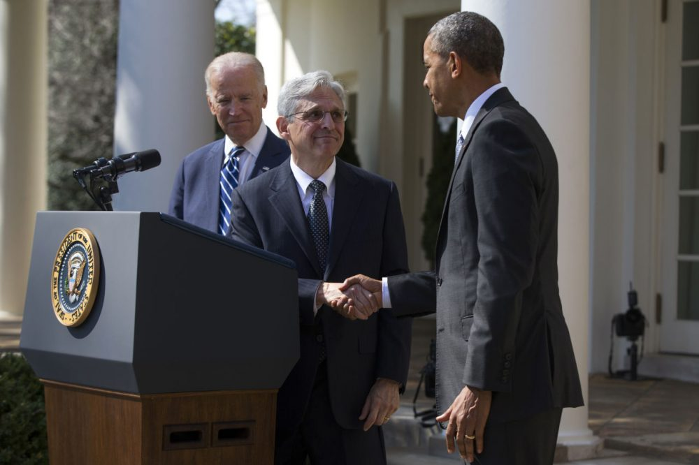 Federal appeals court judge Merrick Garland, center, shakes hands with President Barack Obama, as he is introduced as Obama's nominee for the Supreme Court. (Evan Vucci/AP)