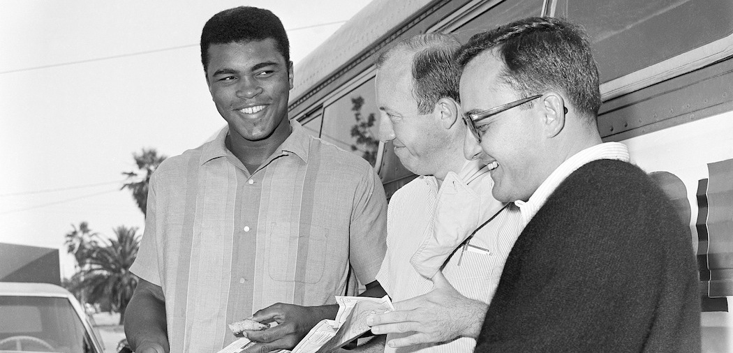 Bud Collins (center) with Muhammad Ali and Edwin Pope, assistant sports editor of the Miami Herald, in 1965. (AP)