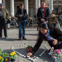 "Mark Edington: ""The coincidence of our week of remembrance and Resurrection with the horrors of bombs and blood confronts us with a perplexing sorrow.""  Pictured: A woman places candles in the shape of a heart outside the stock exchange in Brussels on Tuesday, March 22, 2016. (Geert Vanden Wijngaert/AP)"