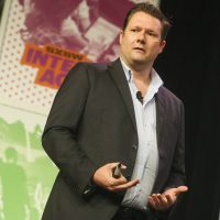 """Thomas J. Fitzgerald: """"What if you could bypass flying and rail and instead use a ground-based form of transit that's not only faster and cleaner, but cheaper?"""" Pictured: Dirk Ahlborn, CEO of Hyperloop Transportations, speaks at the Austin Convention Center during the South by Southwest Interactive Festival on Sunday, March 13, 2016, in Austin, Texas. (Jack Plunkett/AP)"""