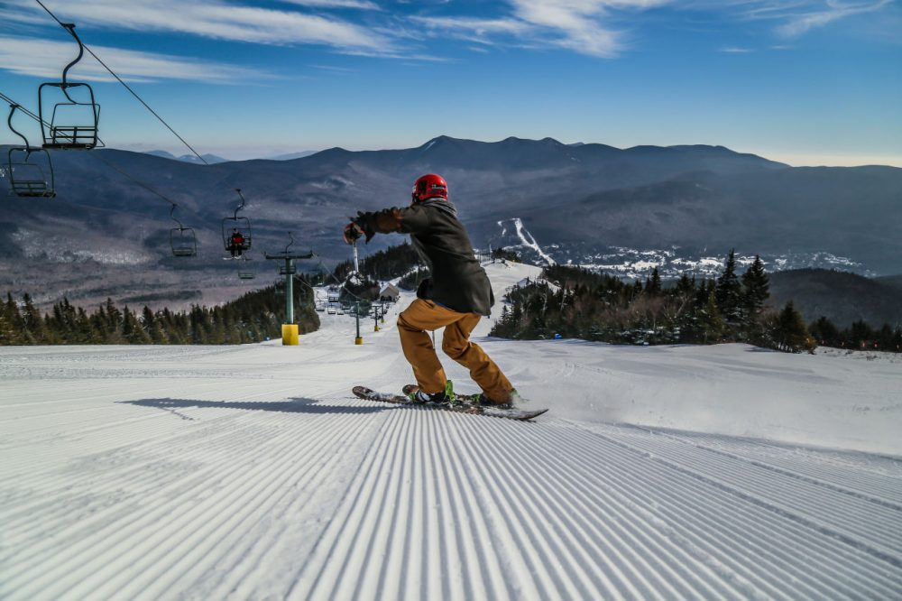 Record temperatures this week have plenty of people packing up their winter gear and looking ahead to spring. But New England ski mountains are hoping folks keep their ski and snowboard gear handy for at least a few more weeks. (Courtesy of Tyler Walker/Waterville Valley Resorts)