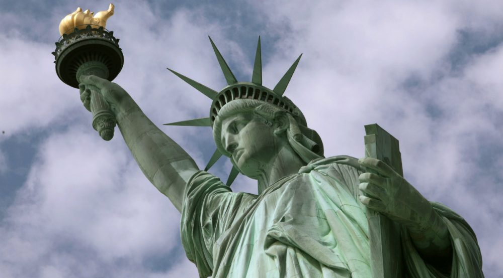 """Eric Silverman: """"Woeful as it is, xenophobia is a time-honored American tradition. But so is the ideal of a more hospitable message."""" Pictured:  The Statue of Liberty. (Richard Drew/AP)"""