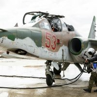 A Russian Su-25 ground attack jet is being refueled for take off at Hemeimeem air base in Syria, Tuesday, March 15, 2016. Russia's defense ministry says another group of its aircraft has left the Russian air base in Syria and is returning home. On Monday, March 14, 2016, Russian President Vladimir Putin ordered Russian military to withdraw most of its fighting forces from Syria, signaling an end to Russia's five-and-a-half month air campaign. (Vadim Grishankin/Russian Defense Ministry Press Service via AP)
