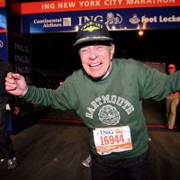 Retired Marine Col. Jonathan Mendes crosses the finish line at the end of the 2010 New York City Marathon. The 90-year-old was the oldest entrant in the race and crossed the finish after 9 hours and 55 minutes. (USMC via Wikimedia Commons)