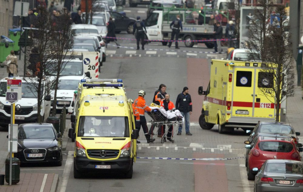 A victim is evacuated on a stretcher by emergency services after a explosion in a main metro station in Brussels on Tuesday. (Virginia Mayo/AP)