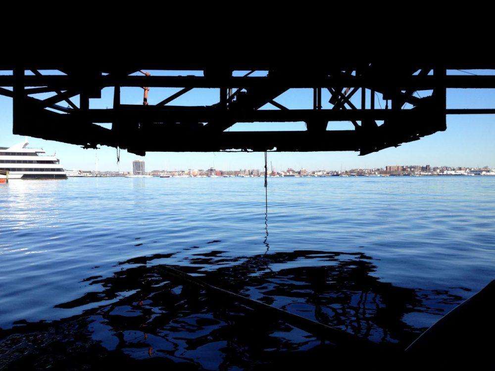 The underbelly of the Northern Avenue Bridge is rusting. (Virginia Marshall for WBUR)