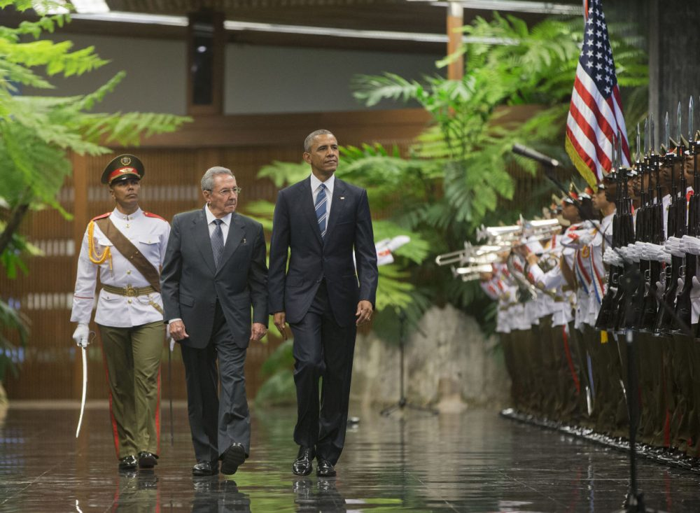 President Barack Obama and Cuban President Raul Castro walk during a welcoming ceremony at the Palace of the Revolution, Monday, March 21, 2016, in Havana, Cuba. (AP Photo/Pablo Martinez Monsivais)
