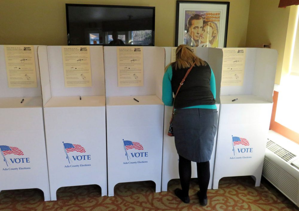 A voter fills out her ballot at the Brookdale Assisted Living Center on the east side of Boise, Idaho. (Tom Banse/Northwest News Network)