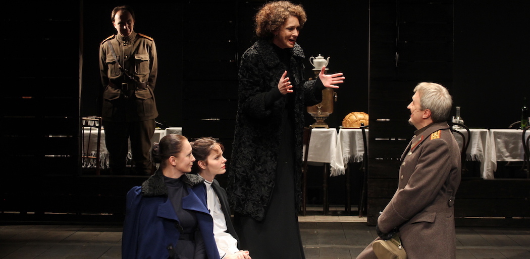 (L-R, foreground) Irina Tychinina, Elizaveta Boyarskaya, Ksenia Rappoport, Igor Chernevich. (Background) Oleg Ryazanzev. (Courtesy Viktor Vassiliev/ArtsEmerson)