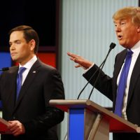 Donald Trump gestures Thursday as Sen. Marco Rubio, R-Fla., listens to Trump's response during a Republican presidential primary debate in Detroit. (AP)
