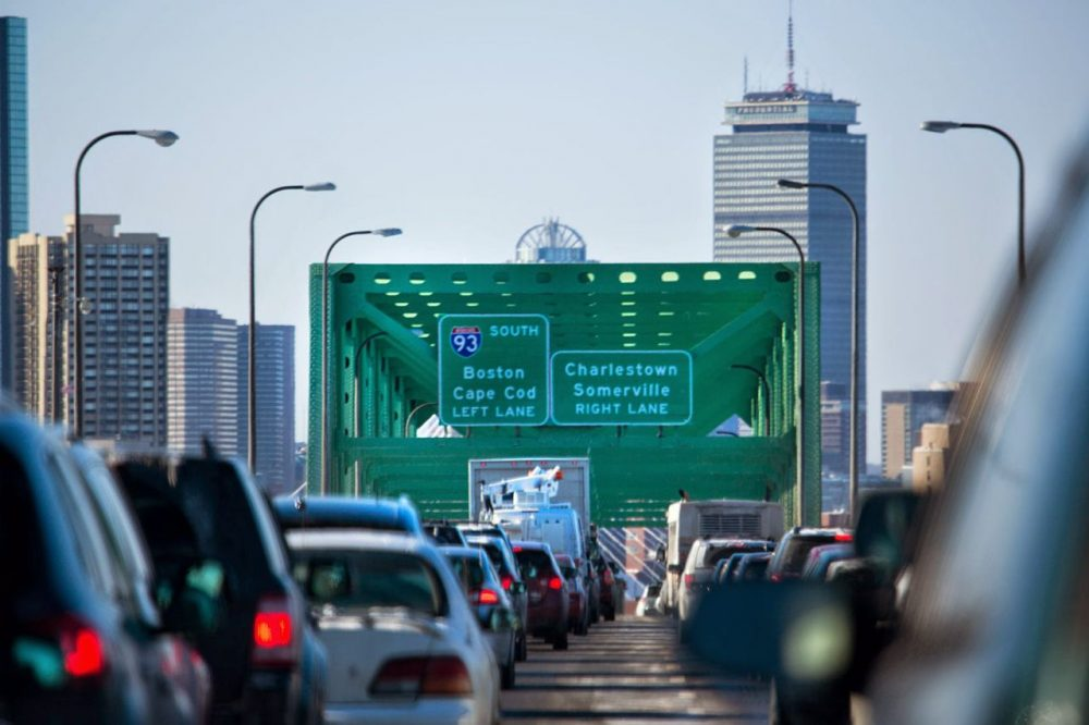 The average car commuter in the region spends 64 hours a year stuck in traffic, a recent report found. (Jesse Costa/WBUR)