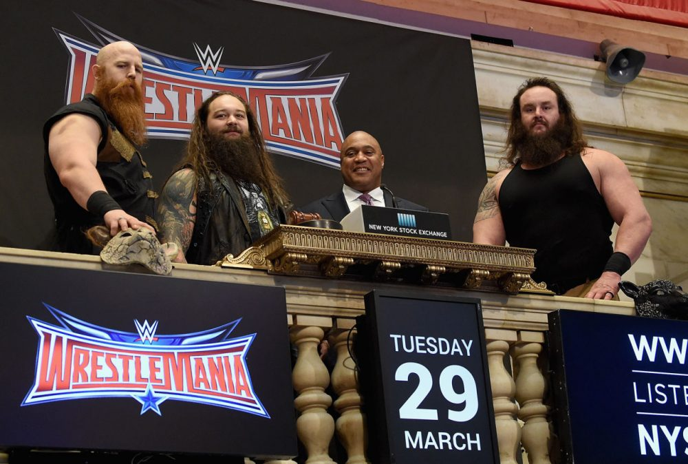 WWE Superstars Erick Rowan, Bray Wyatt and Braun Strowman with NYSE Global head of capital markets Garvis Toler (3rd from left) ring The New York Stock Exchange Opening Bell in honor of WrestleMania 32  at New York Stock Exchange on March 29, 2016 in New York City.  (Jamie McCarthy/Getty Images)
