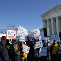 People participate in a rally at the Supreme Court in Washington, Monday, Jan. 11, 2016, as the court heard arguments in the 'Friedrichs v. California Teachers Association' case. (Jacquelyn Martin/AP)