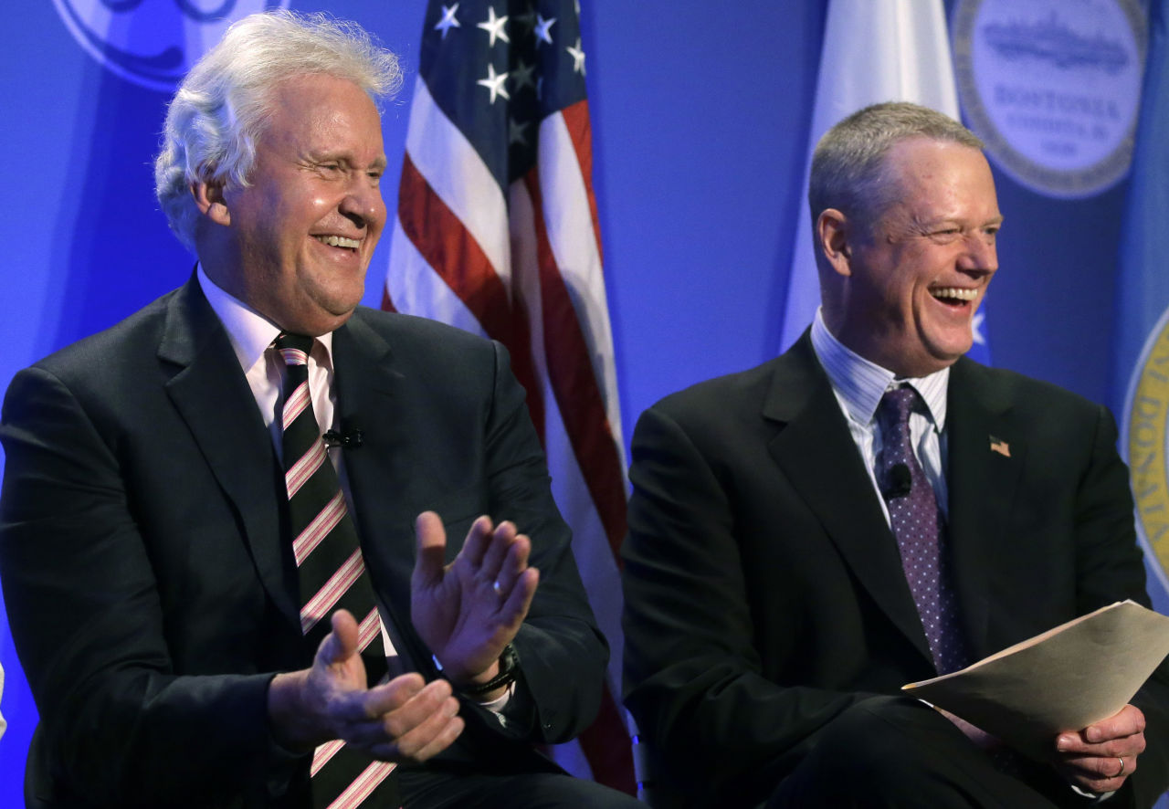 General Electric CEO Jeff Immelt, left, and Gov. Charlie Baker smile during a news conference in Boston on Monday. (Steven Senne/AP)