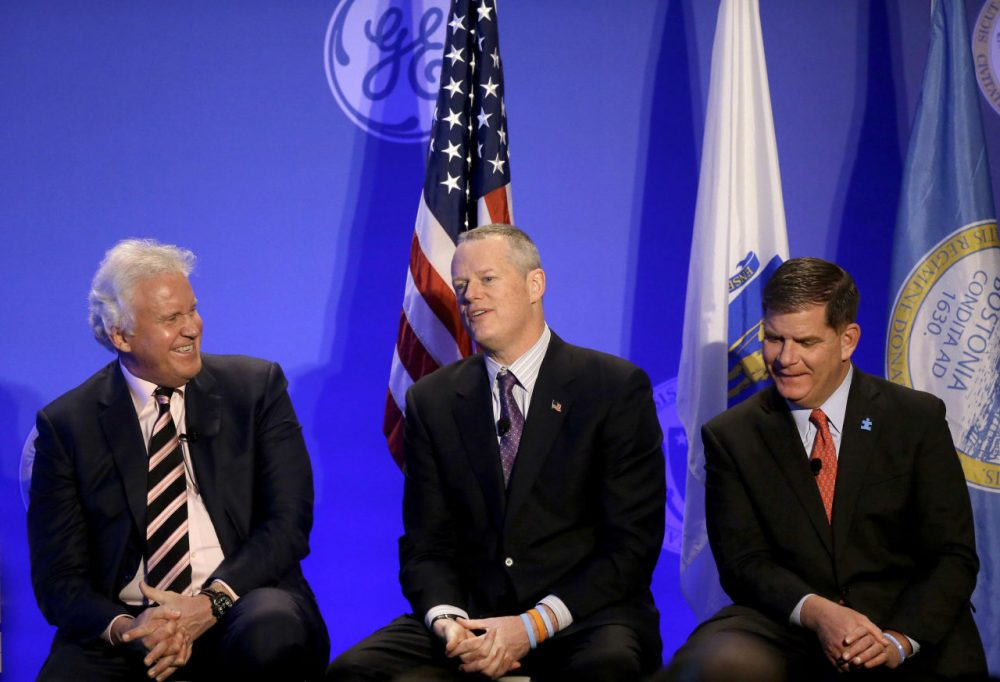 Massachusetts Gov. Charlie Baker, center, takes a question from a reporter as General Electric CEO Jeff Immelt, left, and Boston Mayor Marty Walsh, right, look on during a news conference in Boston, Monday, April 4, 2016. The conference was held to unveil more details about GE's move to the city. (Steven Senne/AP)