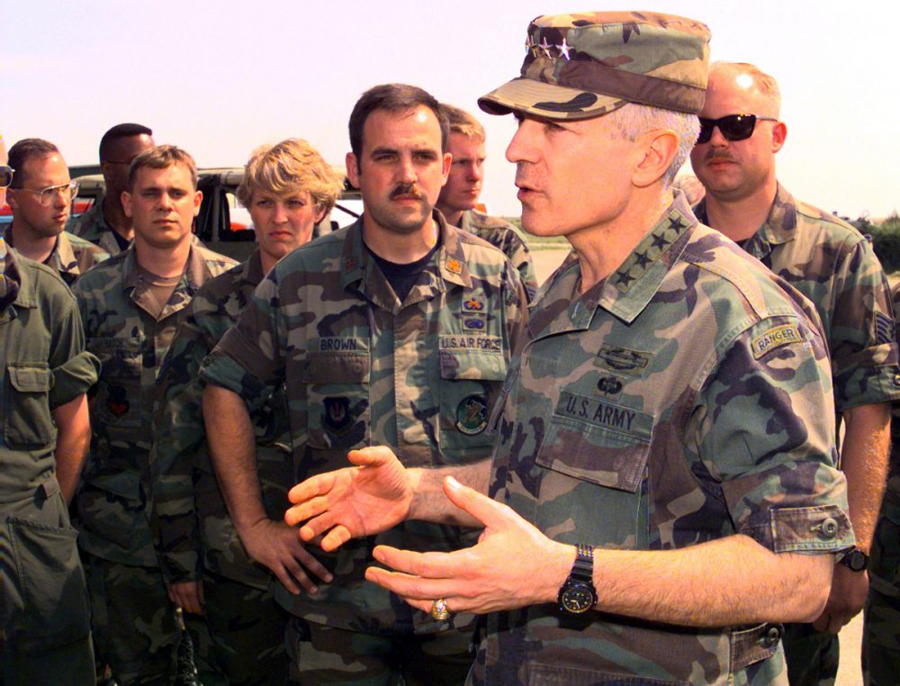 Retired Army General Wesley Clark was the NATO Supreme Allied Commander during the Kosovo War. He is pictured here speaking with U.S. Air Force members on May 13, 1999 at Gioia del Colle Air Base, Italy. The airmen are assigned to the 40th Air Expeditionary Group to support Operation Allied Force. ( Blake R. Borsic/USAF via Getty Images)