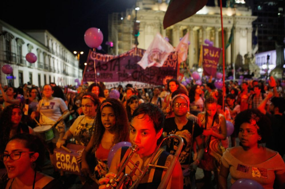 Activists march for women's rights on International Women's Day on March 8, 2016 in Rio de Janeiro, Brazil. Marchers called for myriad reforms including expanded female reproductive rights. Women's reproductive rights have taken on a new focus in Brazil following the onset of the Zika virus outbreak, which authorities strongly suspect is linked to birth defects. (Mario Tama/Getty Images)