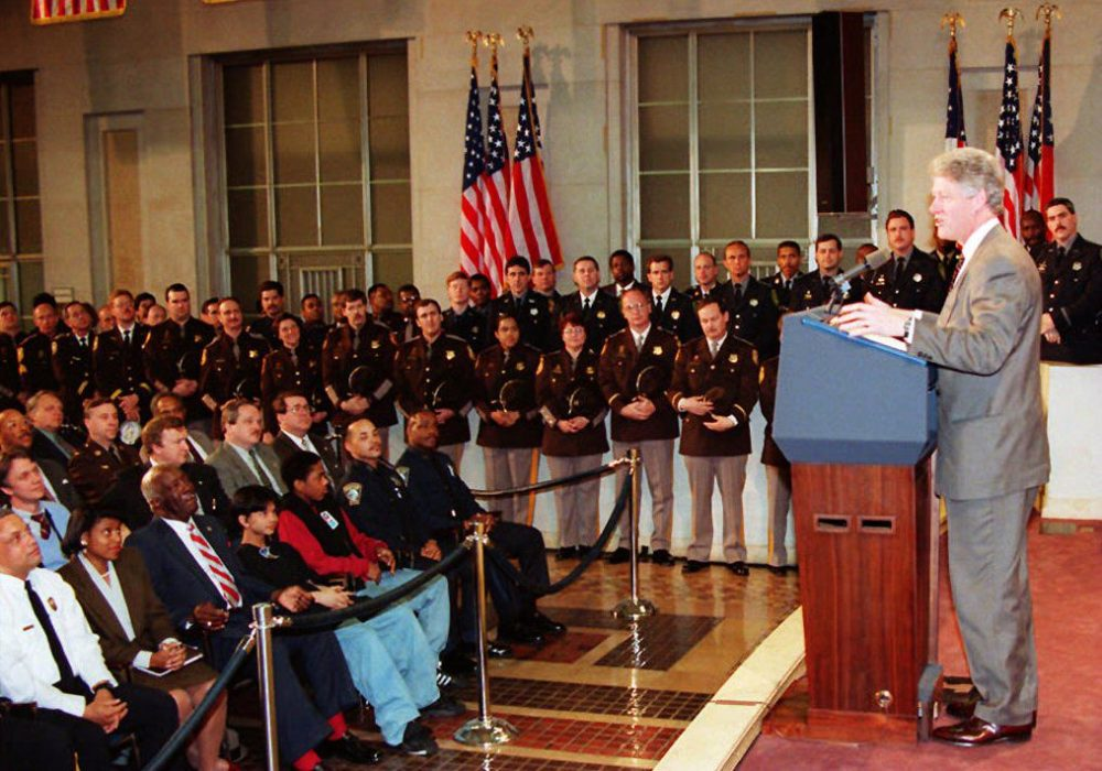 President Bill Clinton speaks about his crime bill to police officers at the Department of Justice, 11 April 1994, in Washington. On the campaign trail for his wife, Hillary, Bill Clinton got into an argument with protestors, who say the Clinton criminal justice reforms led to the mass incarceration of African-Americans. (Joshua Roberts//AFP/Getty Images)