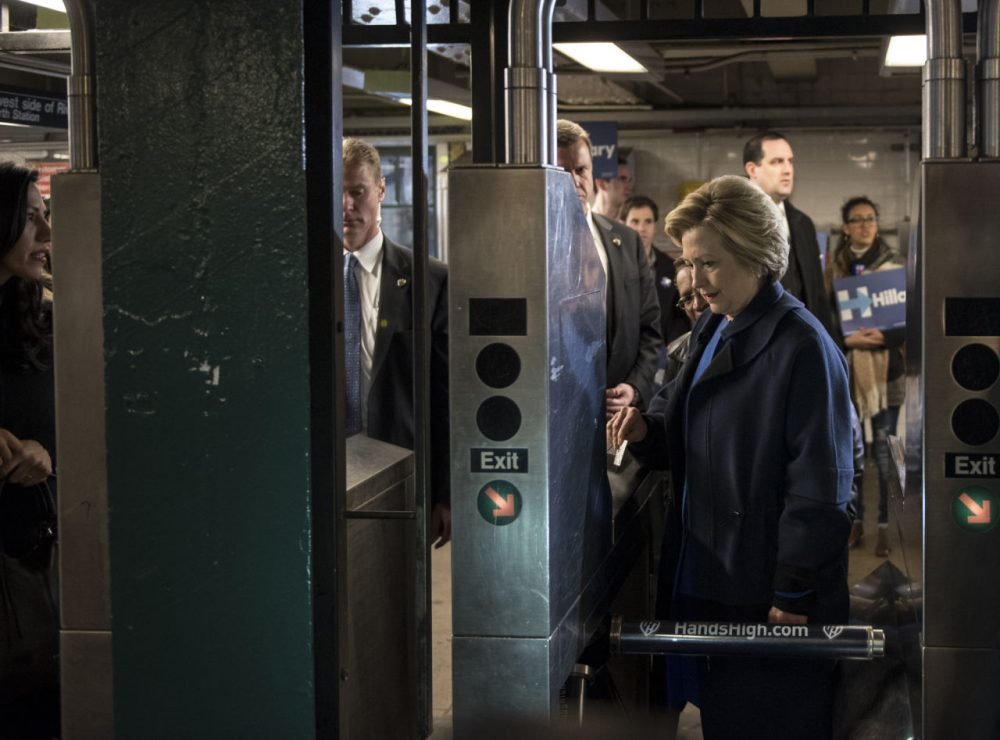 Democratic presidential candidate Hillary Clinton swipes a MetroCard to ride the No. 4 train as she campaigns on April 7, 2016 in the Bronx borough of New York City. The former U.S. secretary of state first spoke outside of Yankee Stadium before riding the subway from the 161st Street station to the 170th Street station.  (Andrew Renneisen/Getty Images)